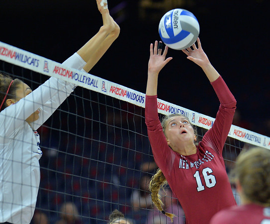 TUCSON, AZ - SEPTEMBER 15:  Natalie Mikels #16 of the New Mexico State Aggies sets a ball in a match between the New Mexico State Aggies and the Arizona Wildcats at the McKale Center in Tucson, Arizona. The Wildcats won 3-2.  (Photo by Sam Wasson)