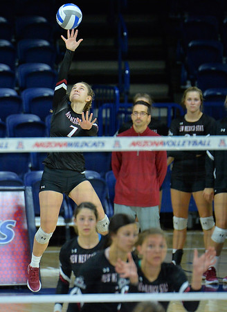 TUCSON, AZ - SEPTEMBER 15:  Kiley Tonge #7 of the New Mexico State Aggies serves a ball in a match between the New Mexico State Aggies and the Illinois State Redbirds at the McKale Center in Tucson, Arizona. The Redbirds won 3-0.  (Photo by Sam Wasson)