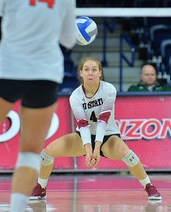 TUCSON, AZ - SEPTEMBER 15:  Ariadnne Sierra #4 of the New Mexico State Aggies digs a ball in a match between the New Mexico State Aggies and the Illinois State Redbirds at the McKale Center in Tucson, Arizona. The Redbirds won 3-0.  (Photo by Sam Wasson)