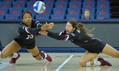 TUCSON, AZ - SEPTEMBER 15:  Sasha-Lee Thomas #20 and Briana Ainsworth #1 of the New Mexico State Aggies dive for a ball in a match between the New Mexico State Aggies and the Illinois State Redbirds at the McKale Center in Tucson, Arizona. The Redbirds won 3-0.  (Photo by Sam Wasson)