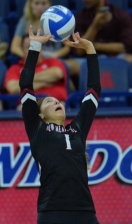 TUCSON, AZ - SEPTEMBER 15:  Briana Ainsworth #1 of the New Mexico State Aggies sets a ball in a match between the New Mexico State Aggies and the Illinois State Redbirds at the McKale Center in Tucson, Arizona. The Redbirds won 3-0.  (Photo by Sam Wasson)