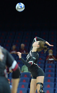 TUCSON, AZ - SEPTEMBER 15:  Megan Hart #12 of the New Mexico State Aggies takes a swing in a match between the New Mexico State Aggies and the Illinois State Redbirds at the McKale Center in Tucson, Arizona. The Redbirds won 3-0.  (Photo by Sam Wasson)
