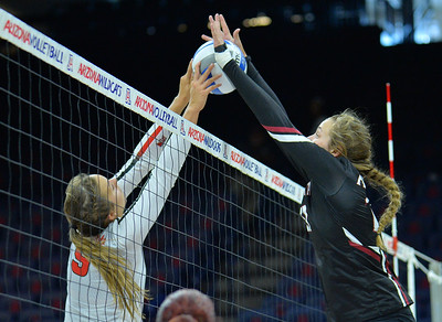 TUCSON, AZ - SEPTEMBER 15:  Lia Mosher #21 of the New Mexico State Aggies goes up for a block against Stef Jankiewicz #9 of the Illinois State Redbirds in a match between the New Mexico State Aggies and the Illinois State Redbirds at the McKale Center in Tucson, Arizona. The Redbirds won 3-0.  (Photo by Sam Wasson)