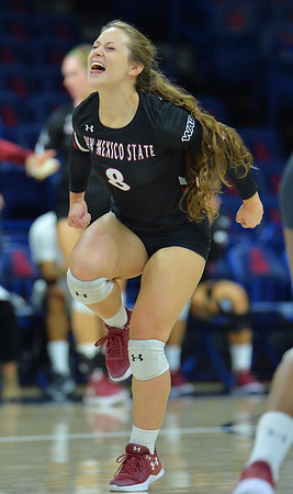 TUCSON, AZ - SEPTEMBER 15:  Kaylee Neal #8 of the New Mexico State Aggies celebrates after her team wins a point in a match between the New Mexico State Aggies and the Illinois State Redbirds at the McKale Center in Tucson, Arizona. The Redbirds won 3-0.  (Photo by Sam Wasson)