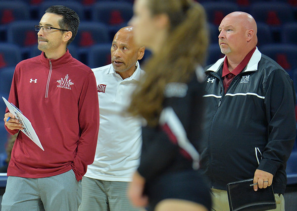 TUCSON, AZ - SEPTEMBER 15:  (L-R) Associate head coach Ben Wallis, associate head coach Keith Rubio and head coach Mike Jordan look on in a match between the New Mexico State Aggies and the Illinois State Redbirds at the McKale Center in Tucson, Arizona. The Redbirds won 3-0.  (Photo by Sam Wasson)