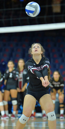 TUCSON, AZ - SEPTEMBER 15:  Kaylee Neal #8 of the New Mexico State Aggies digs a ball in a match between the New Mexico State Aggies and the Illinois State Redbirds at the McKale Center in Tucson, Arizona. The Redbirds won 3-0.  (Photo by Sam Wasson)