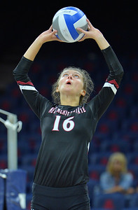 TUCSON, AZ - SEPTEMBER 15:  Natalie Mikels #16 of the New Mexico State Aggies sets a ball in a match between the New Mexico State Aggies and the Illinois State Redbirds at the McKale Center in Tucson, Arizona. The Redbirds won 3-0.  (Photo by Sam Wasson)