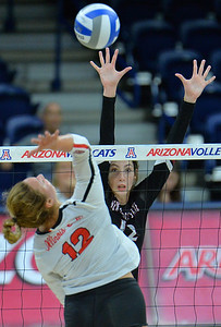 TUCSON, AZ - SEPTEMBER 15:  Megan Hart #12 of the New Mexico State Aggies goes up for a block attempt against Machayla Leonard #12 of the Illinois State Redbirds in a match between the New Mexico State Aggies and the Illinois State Redbirds at the McKale Center in Tucson, Arizona. The Redbirds won 3-0.  (Photo by Sam Wasson)