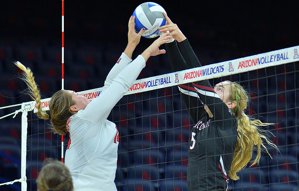 TUCSON, AZ - SEPTEMBER 15:  Brigette Lowe #5 of the New Mexico State Aggies and Lexi Wallen #14 of the Illinois State Redbirds joust at the net in a match between the New Mexico State Aggies and the Illinois State Redbirds at the McKale Center in Tucson, Arizona. The Redbirds won 3-0.  (Photo by Sam Wasson)