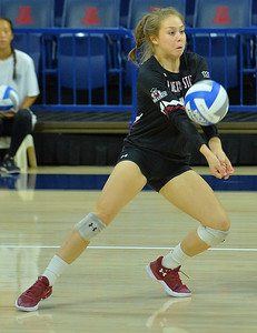 TUCSON, AZ - SEPTEMBER 16:  Ariadnne Sierra #4 of the New Mexico State Aggies digs a ball in a match between the New Mexico State Aggies and the William & Mary Tribe at the McKale Center in Tucson, Arizona. The Aggies won 3-0.  (Photo by Sam Wasson)