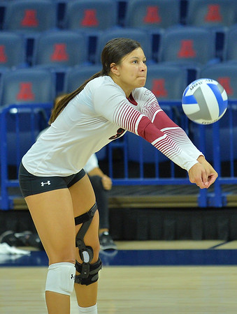 TUCSON, AZ - SEPTEMBER 16:  Jordan Abalos #3 of the New Mexico State Aggies digs a ball in a match between the New Mexico State Aggies and the William & Mary Tribe at the McKale Center in Tucson, Arizona. The Aggies won 3-0.  (Photo by Sam Wasson)