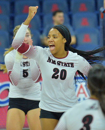 TUCSON, AZ - SEPTEMBER 16:  Sasha-Lee Thomas #20 of the New Mexico State Aggies celebrates after her team wins a point in a match between the New Mexico State Aggies and the William & Mary Tribe at the McKale Center in Tucson, Arizona. The Aggies won 3-0.  (Photo by Sam Wasson)