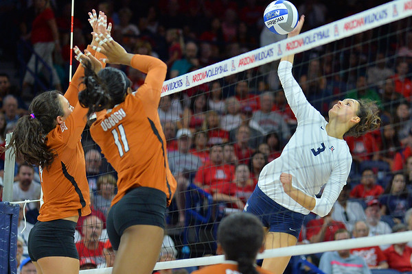 September 18, 2015: Arizona middle blocker Halli Amaro (3) takes a swing in a match between No. 16 Arizona and No. 2 Texas at McKale Memorial Center in Tucson, Ariz.
