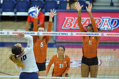 September 18, 2015: Texas middle blocker Molly McCage (5) and Texas middle blocker Chiaka Ogbogu (11) go up for a block on an attack from Arizona outside hitter Kalei Mau (10) in a match between No. 16 Arizona and No. 2 Texas at McKale Memorial Center in Tucson, Ariz.