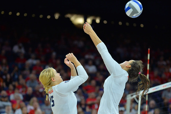 September 18, 2015: Arizona middle blocker Halli Amaro (3) sends a ball over the net in a match between No. 16 Arizona and No. 2 Texas at McKale Memorial Center in Tucson, Ariz.