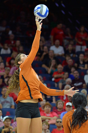 September 18, 2015: Texas outside hitter Paulina Prieto Cerame (19) tips a ball in a match between No. 16 Arizona and No. 2 Texas at McKale Memorial Center in Tucson, Ariz.