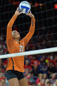 September 18, 2015: Texas middle blocker Chiaka Ogbogu (11) sets a ball in a match between No. 16 Arizona and No. 2 Texas at McKale Memorial Center in Tucson, Ariz.