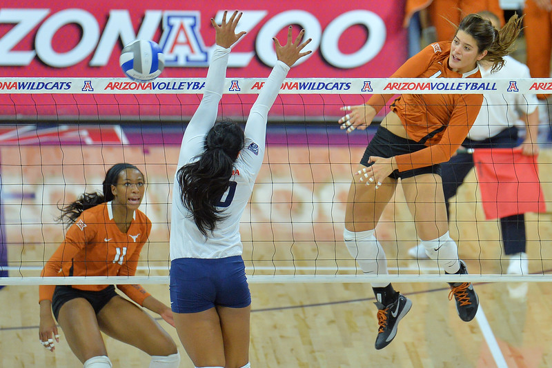September 18, 2015: Texas outside hitter Paulina Prieto Cerame (19) fires a ball past Arizona outside hitter Kalei Mau (10) in a match between No. 16 Arizona and No. 2 Texas at McKale Memorial Center in Tucson, Ariz.