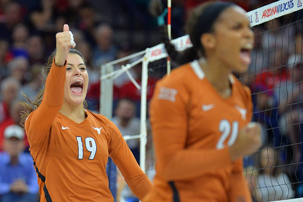 September 18, 2015: Texas outside hitter Paulina Prieto Cerame (19) celebrates a point in a match between No. 16 Arizona and No. 2 Texas at McKale Memorial Center in Tucson, Ariz.