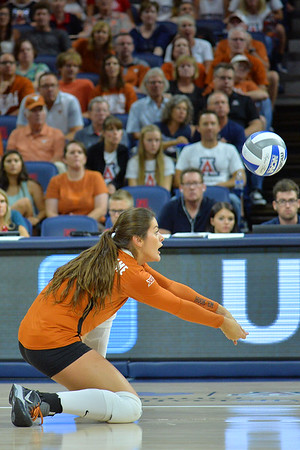 September 18, 2015: Texas outside hitter Amy Neal (9) digs a ball in a match between No. 16 Arizona and No. 2 Texas at McKale Memorial Center in Tucson, Ariz.
