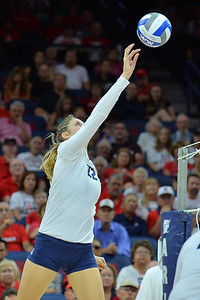 September 18, 2015: Arizona opposite Nikki Attea (22) tips a ball in a match between No. 16 Arizona and No. 2 Texas at McKale Memorial Center in Tucson, Ariz.