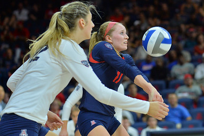 September 18, 2015: Arizona libero/defensive specialist Laura Larson (11) digs a ball in a match between No. 16 Arizona and No. 2 Texas at McKale Memorial Center in Tucson, Ariz.
