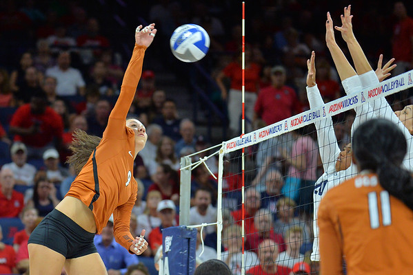 September 18, 2015: Texas outside hitter Amy Neal (9) takes a swing in a match between No. 16 Arizona and No. 2 Texas at McKale Memorial Center in Tucson, Ariz.