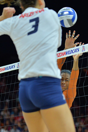 September 18, 2015: Texas middle blocker Chiaka Ogbogu (11) goes up for a block in a match between No. 16 Arizona and No. 2 Texas at McKale Memorial Center in Tucson, Ariz.