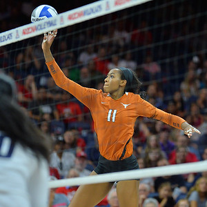 September 18, 2015: Texas middle blocker Chiaka Ogbogu (11) tips a ball in a match between No. 16 Arizona and No. 2 Texas at McKale Memorial Center in Tucson, Ariz.
