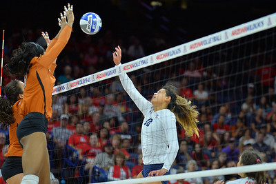 September 18, 2015: Arizona outside hitter Kalei Mau (10) tips a ball over the net in a match between No. 16 Arizona and No. 2 Texas at McKale Memorial Center in Tucson, Ariz.