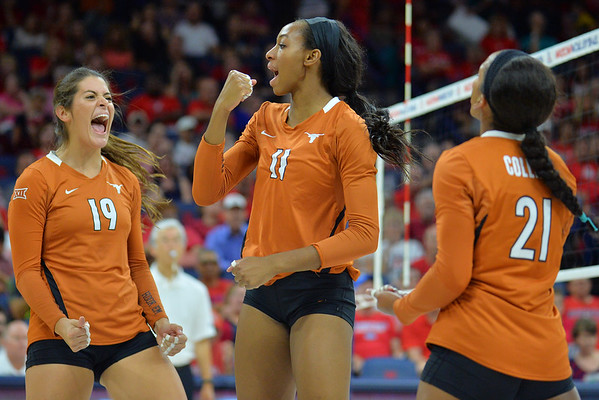 September 18, 2015: Texas middle blocker Chiaka Ogbogu (11), Texas outside hitter Paulina Prieto Cerame (19) and Texas setter Chloe Collins (21) celebrate a point in a match between No. 16 Arizona and No. 2 Texas at McKale Memorial Center in Tucson, Ariz.