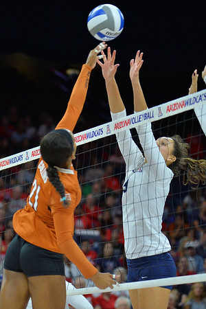 September 18, 2015: Texas setter Chloe Collins (21) tries to tip the ball over the Arizona block in a match between No. 16 Arizona and No. 2 Texas at McKale Memorial Center in Tucson, Ariz.