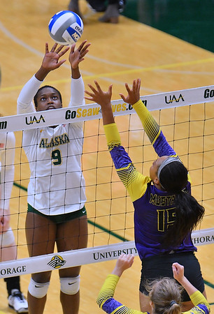 ANCHORAGE, AK - AUGUST 23:  Chrisalyn Johnson #9 of the Alaska Anchorage Seawolves tips an overpass against Christiana DuBose #15 of the Western New Mexico Mustangs during their match at the Alaska Airlines Center on August 23, 2018 in Anchorage, Alaska. The Seawolves won 3-0.  (Photo by Sam Wasson)