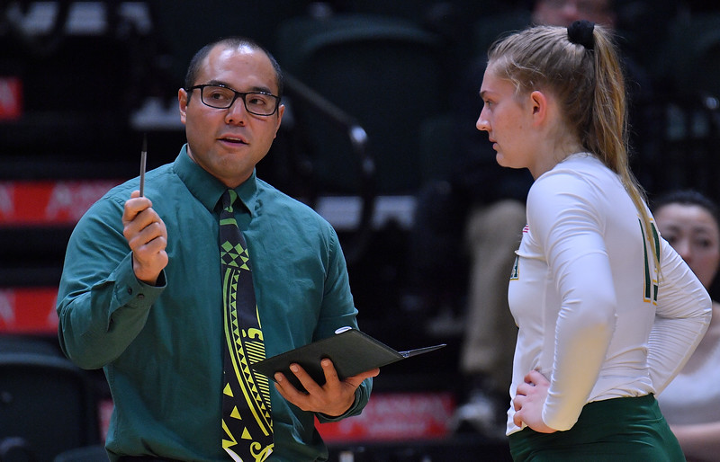 ANCHORAGE, AK - AUGUST 23:  Assistant coach Sheldon Carvalho of the Alaska Anchorage Seawolves talks to Ellen Floyd #13 of the Seawolves during their match at the Alaska Airlines Center on August 23, 2018 in Anchorage, Alaska. The Seawolves won 3-0.  (Photo by Sam Wasson)