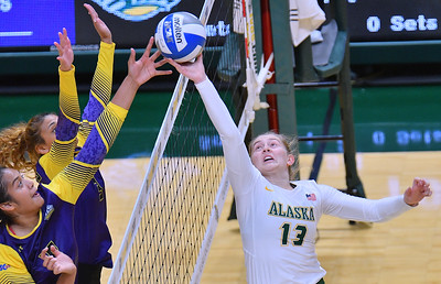 ANCHORAGE, AK - AUGUST 23:  Ellen Floyd #13 of the Alaska Anchorage Seawolves saves an overpass against Deyzha Samuelu (L) #18 and Selai Damuni #3 of the Western New Mexico Mustangs during their match at the Alaska Airlines Center on August 23, 2018 in Anchorage, Alaska. The Seawolves won 3-0.  (Photo by Sam Wasson)
