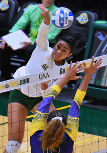 ANCHORAGE, AK - AUGUST 23:  Taylor Noga #5 of the Alaska Anchorage Seawolves takes a swing against Deyzha Samuelu #18 of the Western New Mexico Mustangs during their match at the Alaska Airlines Center on August 23, 2018 in Anchorage, Alaska. The Seawolves won 3-0.  (Photo by Sam Wasson)