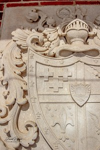 Coat of Arms relief set in the Sigma Alpha Epsilon fraternity house on the campus of the University of South Dakota. Phi Alpha and hold hands.
