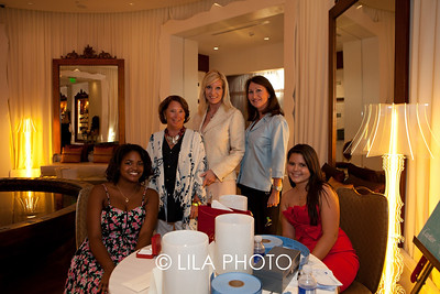 Guests bidding on auction items; L-R: J'Lysa Wilson (seated), Valerie Fennon, Lyn Heck, Gail Mills, Alexandra Rydberg (seated)