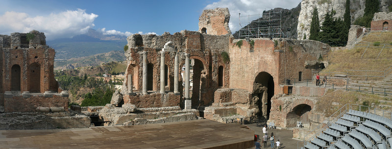 Greek amphitheatre in Taormina with Etna in the distance.