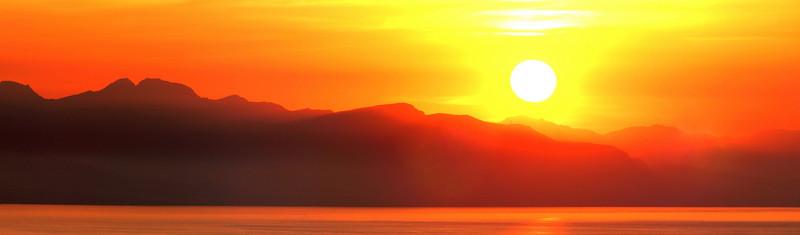 Sunset over Sicilian coastline near Cefalu