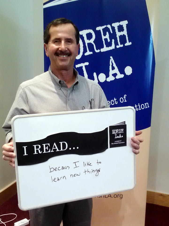 """Volunteer Jack Feldman of Canoga Park elementary READS """"because [he] likes to learn new things."""""""