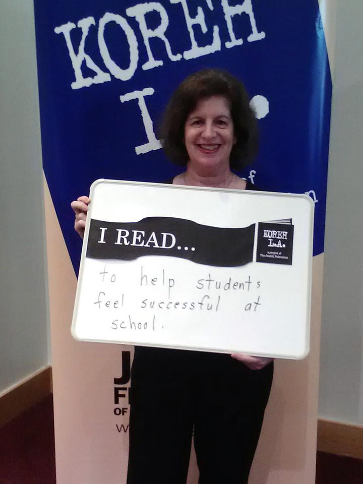 "Volunteer Hope Seldin of Castle Heights elementary READS ""to help students feel successful at school."""