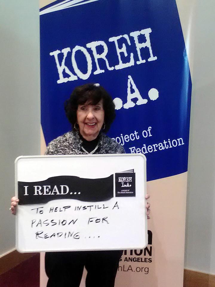 "Volunteer Susan Kolker of Tarzana elementary READS ""to help instill a passion for reading."""