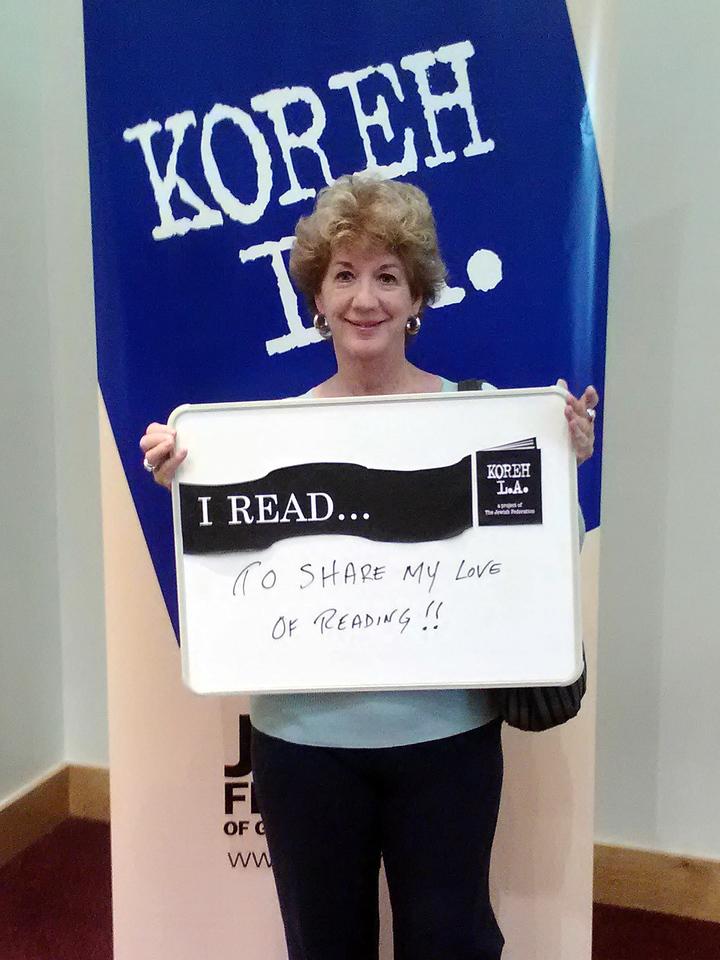 "Volunteer Kathleen Ebert of Tarzana elementary READS ""to share [her] love of reading."""