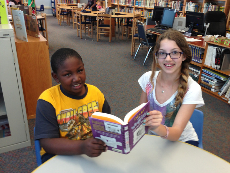 KOREH L.A. volunteer Danielle B. and 3rd grader Eric G. at Castle Heights Elementary.