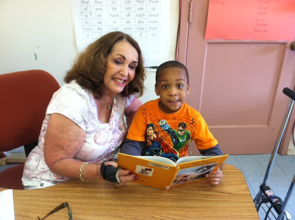 KOREH L.A. volunteer Eileen P. and Kindergartener Jason C. at Fullbright Elementary.