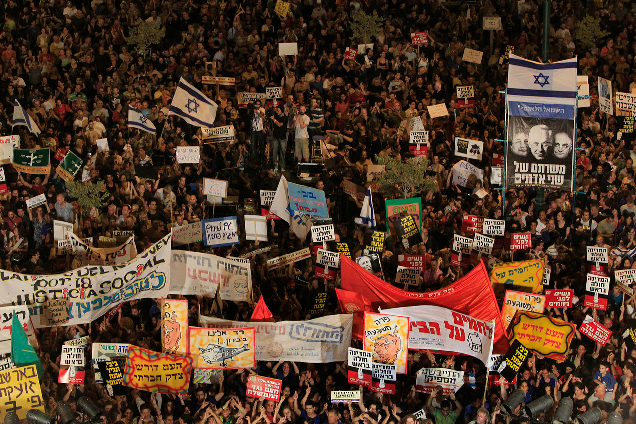 Israelis gather during a protest against the costs of living in Israel in Beersheba, southern Israel, Saturday, Aug. 13, 2011.  Tens of thousands of Israelis poured into streets across the country Saturday for a fourth consecutive week, expanding their protest movement against the nation's high cost of living from major central cities to smaller ones in outlying areas. (AP Photo/Tsafrir Abayov)