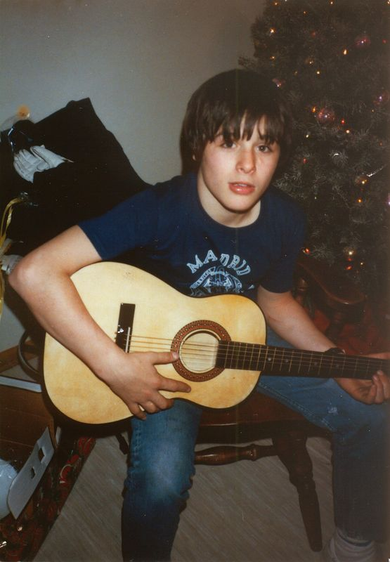 This is a scan of a pretty old print. The camera was an Olympus XA. This is me right after opening my first guitar, given to me by my grandparents for Christmas in 1982. Photo taken by my dad, Paul Franz.