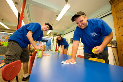 (left to right) Westfield State University students Brian Niemi, class of 2015, and resident of Hudson, MA, Danielle Phelps, class of 2014, from Webster, MA and Nick Atcheson, class of 2014 from Barnstable, MA work on cleaning up the tables in the kids room at the Westfield Athenaeum as part of WSU's HOOT Day (Helping Out Our Town) Tuesday Sept. 6th 2011