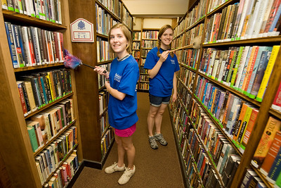 Westfield State University students Katherine Bush (left), class of 2015, and resident of Westford, MA  and Rebecca Hoff, class of 2015, from Maynard, MA work on cleaning up bookshelves at the Westfield Athenaeum as part of WSU's HOOT Day (Helping Out Our Town) Tuesday Sept. 6th 2011